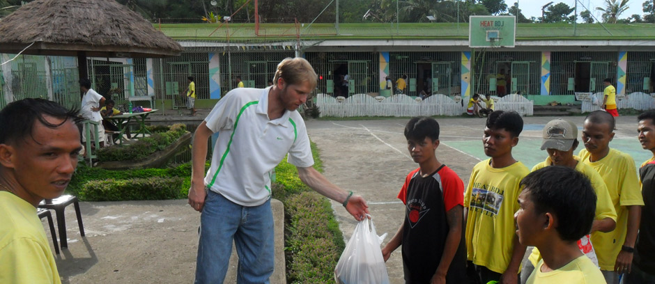 Giving care packages to the inmates of a prison in the Philippines